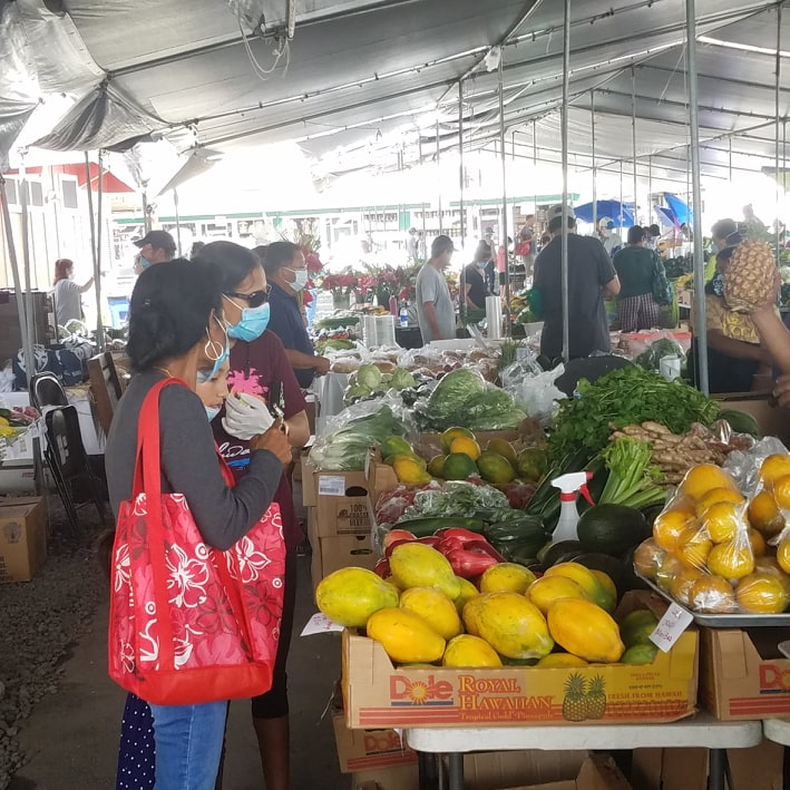 face masks and social distancing at a farmers market in Hawaii