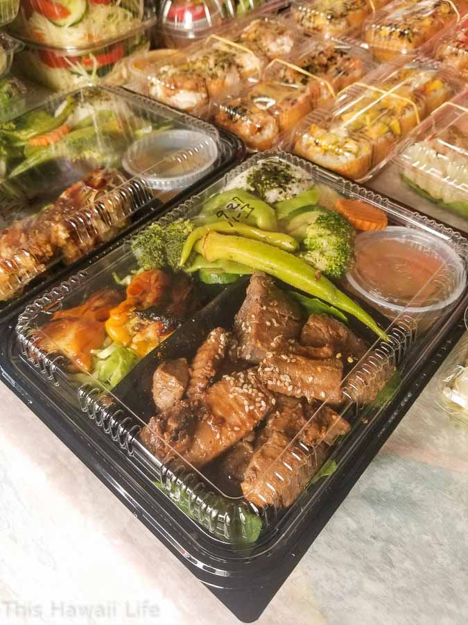 food bento boxes for sale at the farmers market in Hawaii