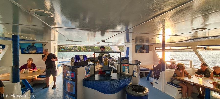Entering the main level of the kanoa Kona ocean adventure cruise