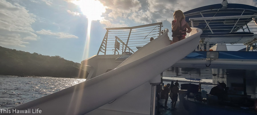 Sliding fun from Kanoa's 2nd story slide to ocean