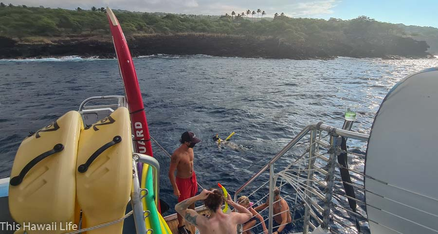 Putting on snorkel gear by the back ladders