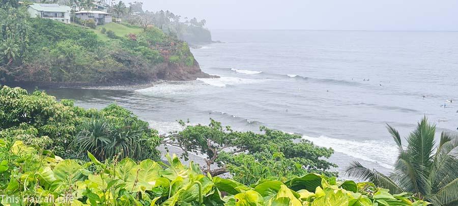 Surfing fun at Honolii Beach in Hilo, Hawaii