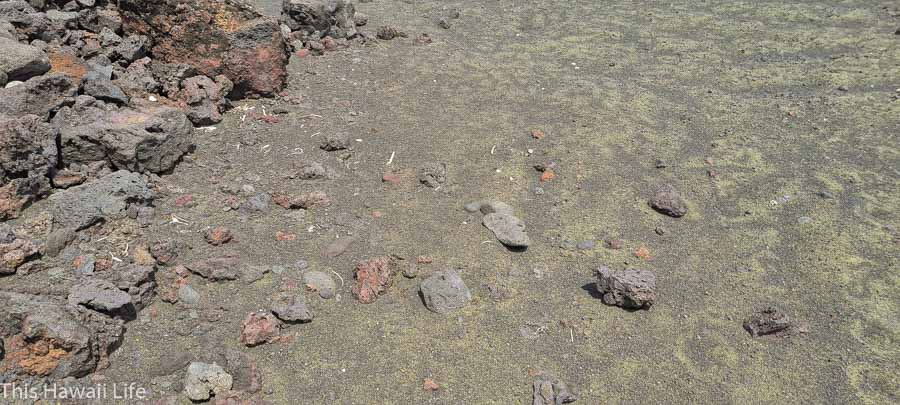 combination of black and green sand made with olivine minerals
