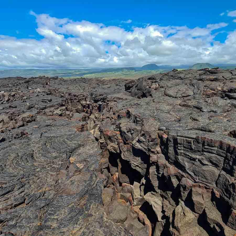 Lava cracks along the lava fields hiking to Kamehame Beach from Punalu'u